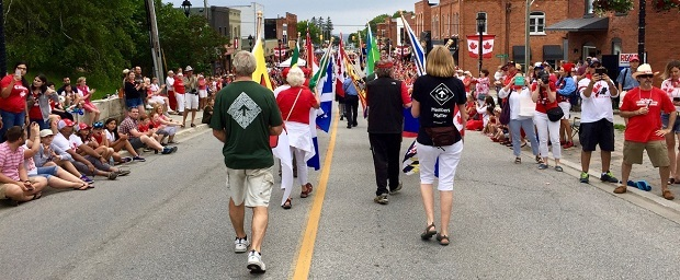 BVBTC members carry flags of the provinces at the Canada Day Parade from Clarksburg to Thornbury in 2017.