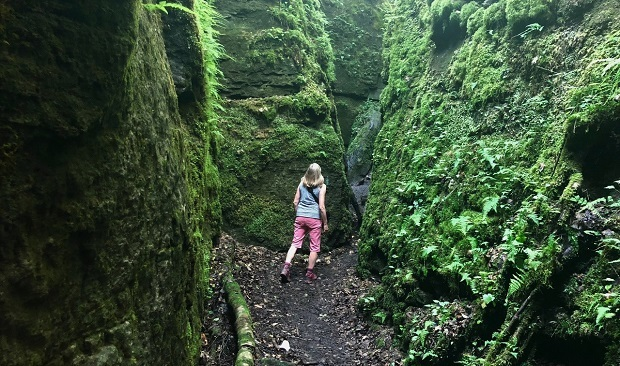 Exploring crevice caves along Standing Rock and Caves side trail on the Bruce Trail. Photo K Yaraskavitch 2018.