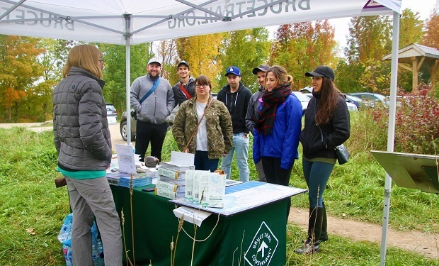 Hikers at Bruce Trail booth at Metcalfe Rock for Bruce Trail Day